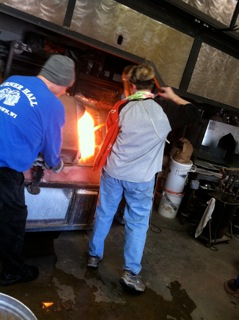 scooping the glass from the furnace
